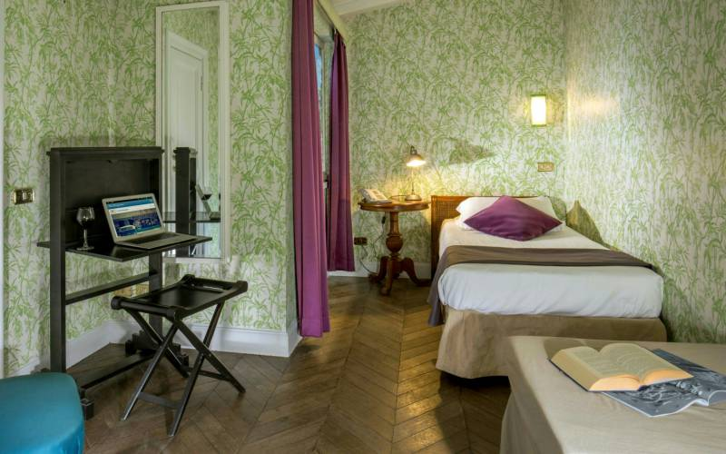 boutique-hotel-anahi-rome-white-suite-top-floor-room-purple-curtains-desk-21