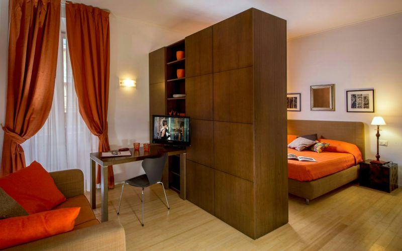 hotel-anahi-rome-apartment-closet-orange-bed-22