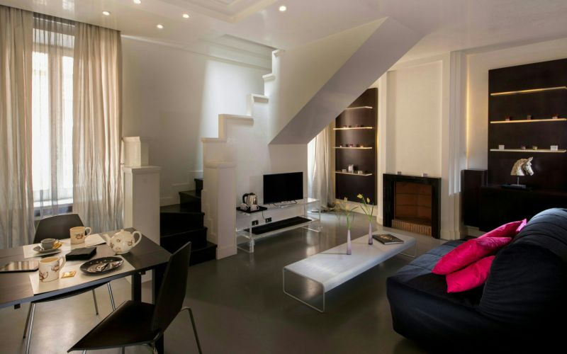 hotel-anahi-rome-apartment-closet-couch-table-stairs-44-2