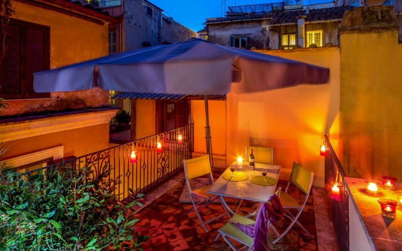 hotel-rome-centre-boutique-hotel-anahi-rome-apartment-table-terrace-candles-outside-view-62